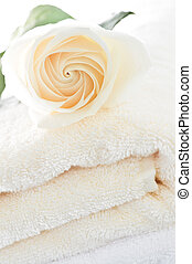 Stack of towels and rose