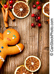 Christmas Holiday Background Gingerbread Man over Wood