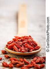 Dried goji berries - Wooden tablespoon of dried goji berries