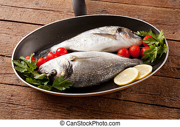 Two sea bream in pan