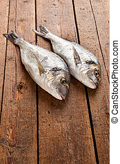 Sea bream on wooden table