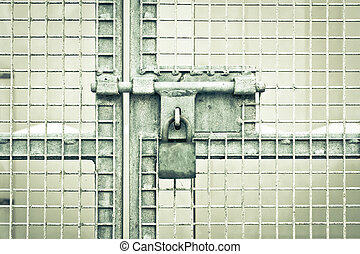 Gate padlock - A padlocked metal gate in dramatic monochrome