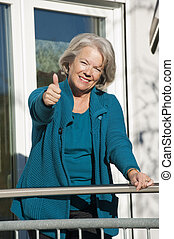 Senior woman holding thumps up