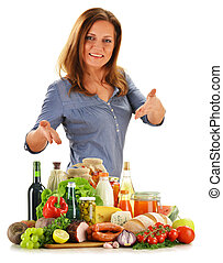 Young woman with variety of grocery products isolated on...