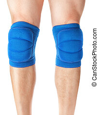 Knee pads to protect the games on male legs. On a white...