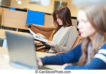 female student girl with book in library
