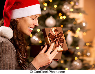 Christmas. Happy Surprised Woman opening Gift box