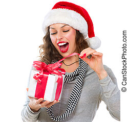 Beautiful Young Woman Opening Christmas Gift Box. Surprised...