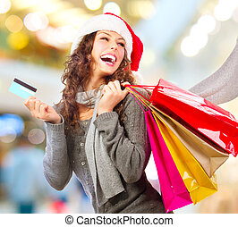 Christmas Shopping Girl With Credit Card In Shopping...