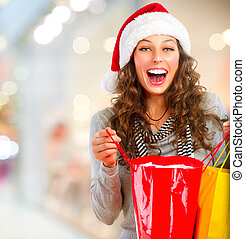 Christmas Shopping Happy Woman with Bags in Mall Sales