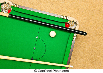 pool table - A small pool table on the floor