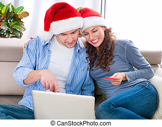 Christmas Online Shopping. Couple Using Credit Card to...