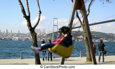 swing - little child swaying swing bosporus bridge...