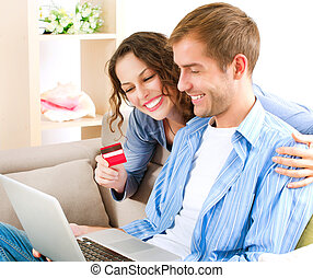 Online Shopping Couple Using Credit Card to Internet Shop