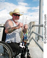 Catch of the Day - Disabled vet on the pier fishing at Fort...