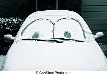 Car covered in snow - A snow-covered in car with a funny...