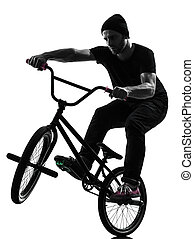 man bmx acrobatic figure silhouette - one caucasian man...