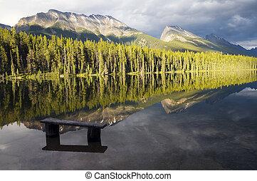 Honeymoon Lake Reflection - Evening sun striking the...