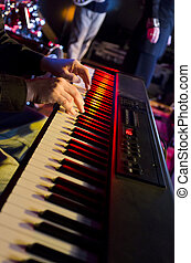 Keyboard Player's Hands - Selective focus on the hands on...