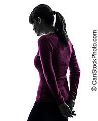 woman sad moody rear view silhouette - one caucasian woman...