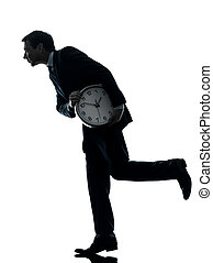 business man holding clock robbing time silhouette - one...