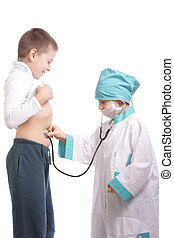 Diagnostics - Two brothers playing as doctor examining...
