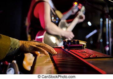 Focus on Keyboard - Selective focus on the hands on the...