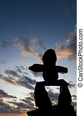 Inukshuk Silhouette Sunset - Selective focus on the Inukshuk...