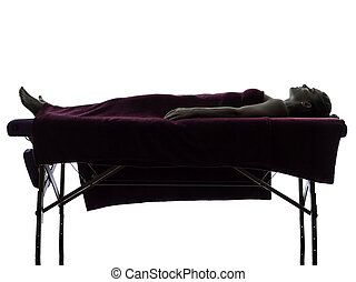 woman massage therapy - one woman lying on a massage table...