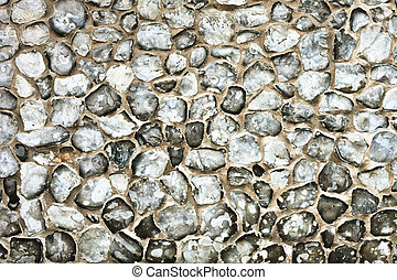 Flint stone wall - Flint stones set in a concrete as a...
