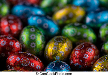 Beautiful colorful tiny Easter Eggs on black background.