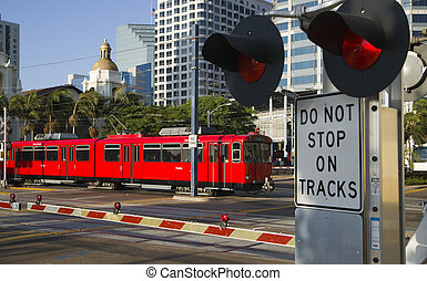 Downtown Scene at RailRoad Crossing Red Trolley Car Passing...