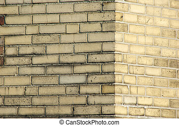 yellow brick wall - background image of corner of yellow...
