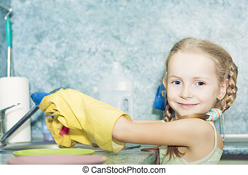 little preschooler girl makes kitchen dishes cleaning -...