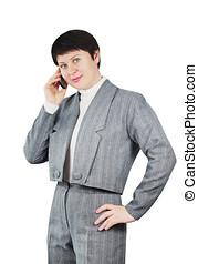 Woman Dressed In Gray Suit Talks By Phone