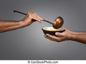 Feed the World - man holding a bowl in both hands, receiving...