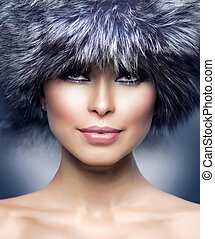 Fashion. Beautiful Girl in Fur Hat. Winter Woman