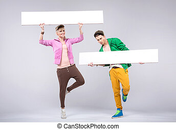 Cheerful teenagers wearing colorful clothes - Cheerful...