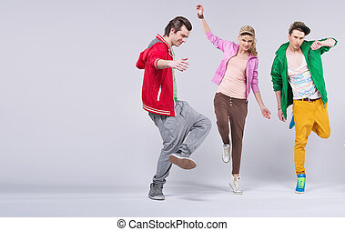 Cheerful young friends dancing together - Group of cheerful...