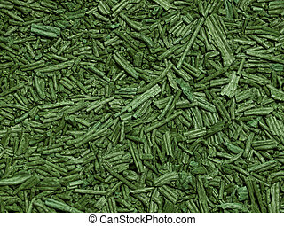 Spirulina background - Macro of green dry spirulina flakes...