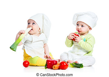 babies boy and girl wearing a chef hat with healthy  food vegetables