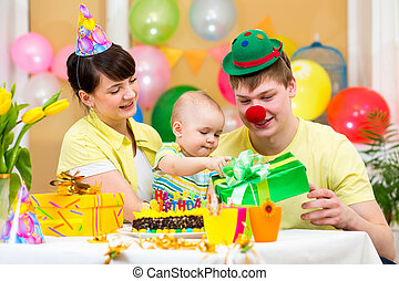 family celebrating first birthday of baby