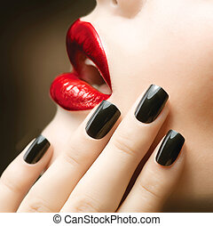 Makeup and Manicure. Black Nails and Red Lips