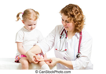 Girl with scratched knee. Doctor curing kid isolated on...