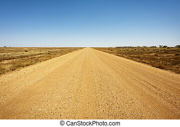 Dirt Road - A long, straight dirt road disappears into the...