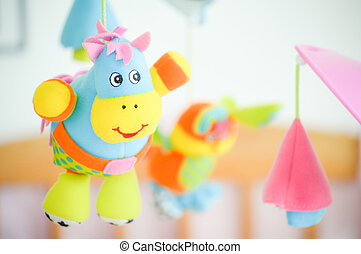Infants baby toys - An infants baby toy isolated against a...