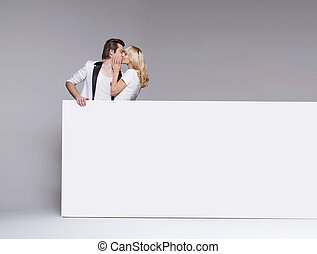 Photo of a kissing young couple