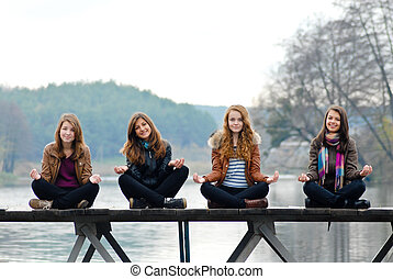 Young girls on the wooden bridge