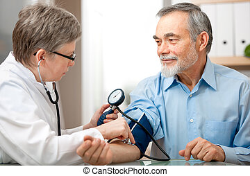 Medical exam - Doctor measuring blood pressure of male...