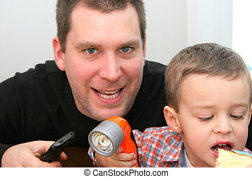 Man and toddler making faces - Man and toddler making funny...